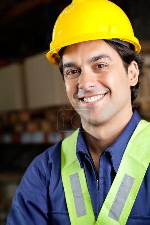 Handsome Foreman Smiling At Warehouse