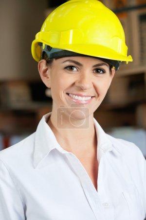 Female Supervisor Wearing Hardhat At Warehouse