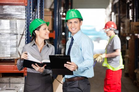 Supervisors And Foreman Working At Warehouse