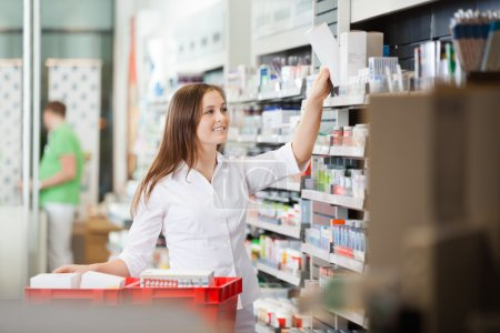 Pharmacist Stocking Shelves