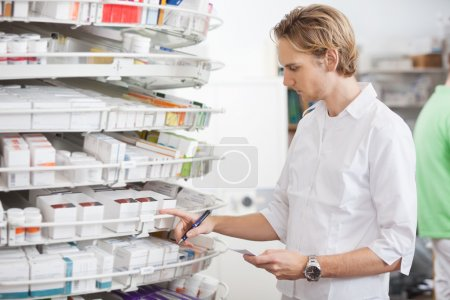 Male Pharmacist Filling Prescription
