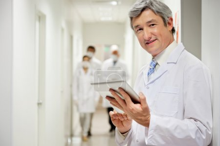Doctor Holding Digital Tablet