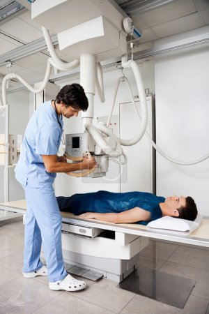 Technician Taking Patient's X-ray