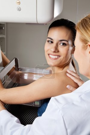 Young Female Patient Undergoing Mammogram X-ray Test