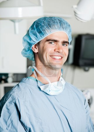 Cheerful Male Surgeon In Operating Room