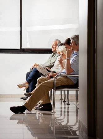 Photo for Group of sitting in waiting area of hospital - Royalty Free Image