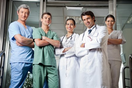 Medical Professionals Standing With Hands Folded