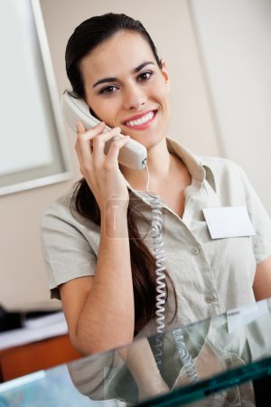 Female Receptionist Answering Call