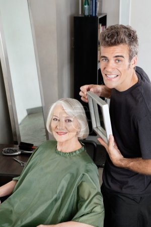 Customer With Hairdresser Holding Mirror