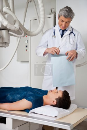 Male Radiologist With Patient