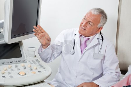 Radiologist Showing Something At Screen