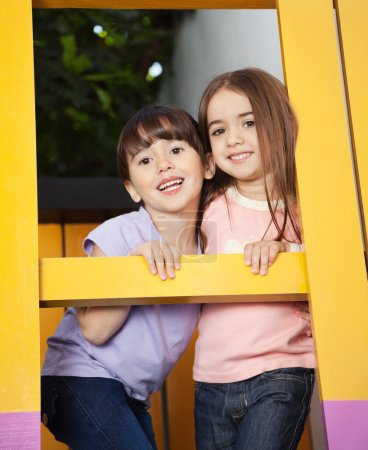 Girl With Friend Playing In Playhouse