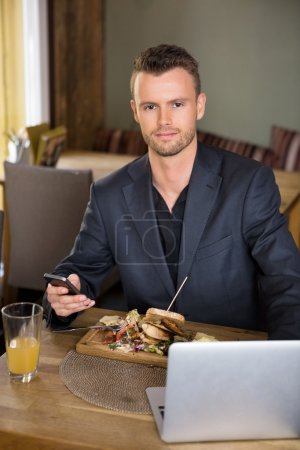 Business man With Mobile phone And Laptop