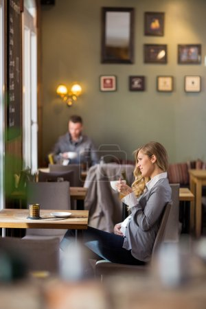 Pregnant Woman Having Coffee While Looking Away