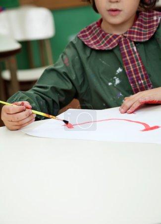 Little Boy Painting In Art Class