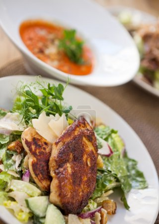 Roasted Chicken Salad In Plate With Dish In Background