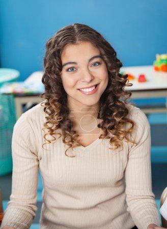 Beautiful Teacher With Smiling In Kindergarten