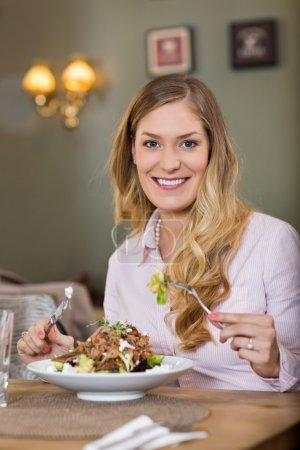 Young Woman With Plate Of Meat Salad
