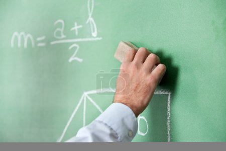 Male Teacher'S Hand Wiping Board With Duster