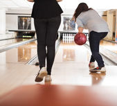 Women Playing in Bowling Alley