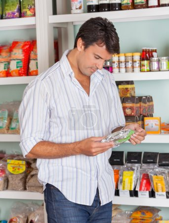 Man Choosing Product In Store