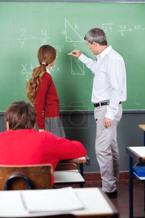 Professor Teaching Mathematics To Teenage Schoolgirl