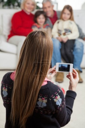 Mother Photographing Family Through Smartphone
