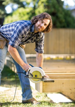 Carpenter Using Circular Saw