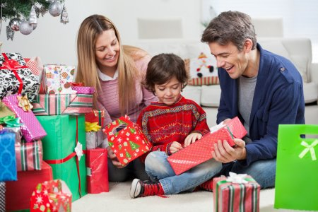 Parents Giving Christmas Present To Son