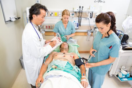 Doctor And Nurses Treating Critical Patient