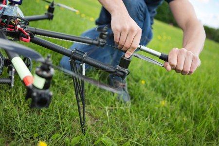 Technician Tightening Propeller Of UAV Drone