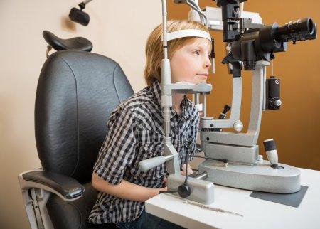 Boy Undergoing Eye Examination With Slit Lamp