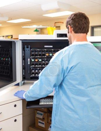 Lab Tech Working with Hematology Analyzer