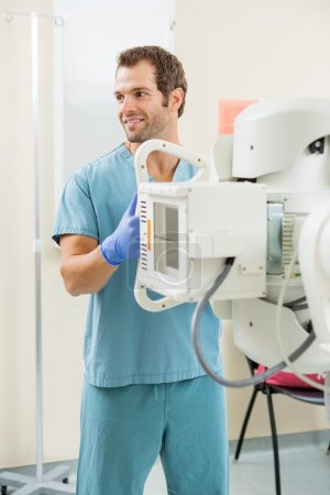 Nurse Adjusting Xray Machine