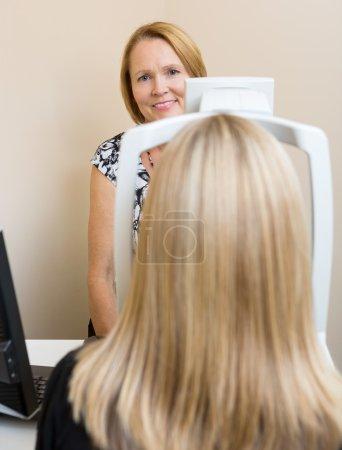 Optometrist Using Digital Retina Camera