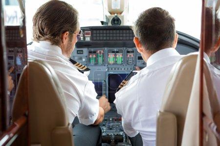 Pilot And Copilot In Private Jet Cockpit