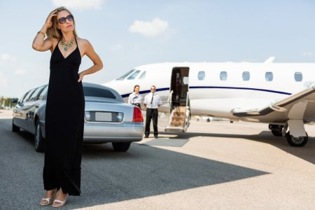 Wealthy Woman In Elegant Dress At Airport Terminal