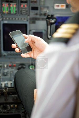 Pilots Using Smartphone In Cockpit