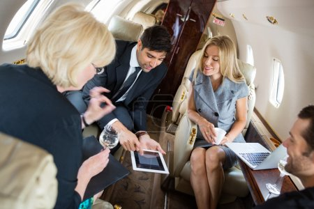 Business People Meeting In Private Jet