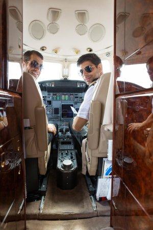 Confident Pilot And Copilot In Cockpit