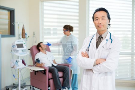 Doctor With Patient Being Examined By Pulse Rate Machine