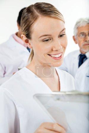 Technician Looking At Clipboard