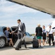 Business partners about to board private jet while...