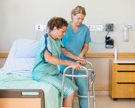 Patient With Walker While Nurse