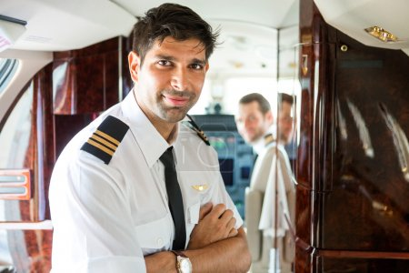 Confident Pilot In Private Jet