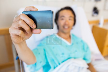 Patient Taking Self Portrait Through Mobile Phone In Hospital