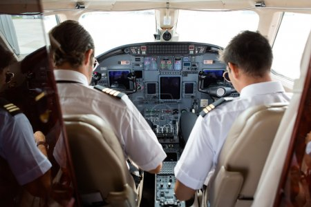 Pilot And Copilot In Cockpit