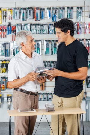 Father And Son Buying Tools In Store