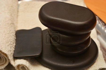 Stone therapy and massage gua sha