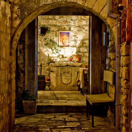 Romantic mediterranean restaurant entrance at nigh...